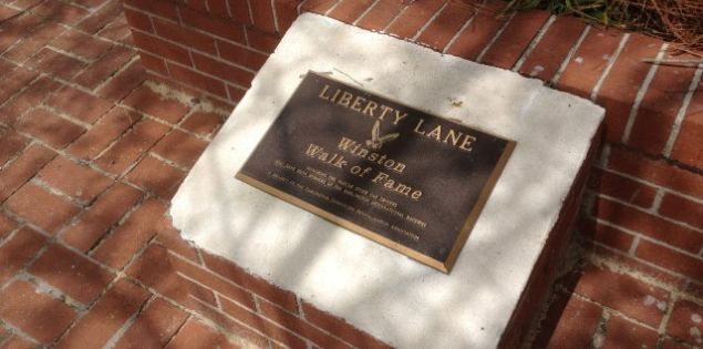 The Liberty Lane Winston Walk of Fame features the handprints of NASCAR drivers who have won at Darlington Raceway.